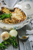 Homemade French Onion Soup with Cheese and Toast on a wooden background - 247032091