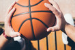 Man holds the ball for basketball