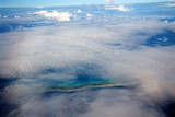 Aerial view of an Atoll island in the Pacific Ocean under clouds - 247038807