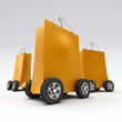 Leinwanddruck Bild - Orange shopping bags on wheels