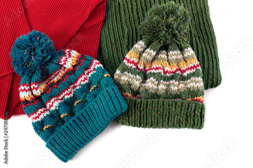 ec8324649fe Two bobble ski hats and scarves isolated