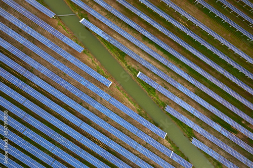 Aerial photography of small river water and solar photovoltaic panels