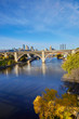 Concrete white arch bridge over the Mississippi River in Minneapolis, Minnesota USA