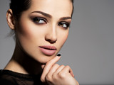 Face of a beautiful girl with smoky eyes makeup - 247121889