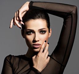 Face of a beautiful girl with fashion makeup and black nails © Valua Vitaly