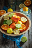 Healthy mix of citrus fruits with on rustic table - 247123217