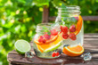 Leinwandbild Motiv Healthy lemonade with mix of citrus with in summer