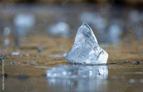 Abstract photo of piece of ice in a frozen lake in Gredos with bokeh effect © JoseMiguel