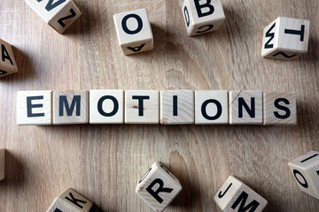 Emotions word from wooden blocks on desk