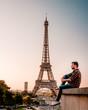Paris Eiffel tower man watching sunrise Sunrise by Eifel tower Paris