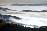A white mist has covered Rhodope mountain in Bulgaria. Sea of thick fog. Only the high parts of the mountain can be seen. - 247163628
