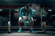 Attractive Caucasian man in sweatshirt and shorts preparing to lift barbells. Chalk all around, in background mirror.