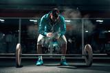 Attractive Caucasian man in sweatshirt and shorts preparing to lift barbells. Chalk all around, in background mirror. - 247173856