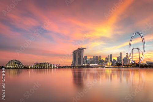 Gorgeous Singapore Skyline buildings with illuminations on sunset
