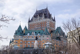 Scenic view of old castle on hill in capital of Quebec province in Canada. Depressive beautiful winter look of historical building in Quebec city - 247192044