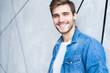 Leinwanddruck Bild - Perfect man. Portrait of happy fashionable handsome man in jeans shirt.