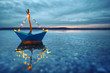 Leinwanddruck Bild - romantischer Abend - leuchtendes Boot am Strand