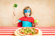 Leinwanddruck Bild - Superhero child eating superfood