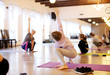Leinwandbild Motiv children practicing yoga on mats with an instructor