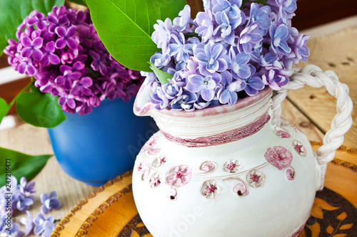 Bouquet of lilac blossoms and leaves - 247216471