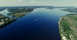 Aerial Barge Floating In River.Drone Ship Passing River.Cargo Barge Floating On Lake.Tug Boat Loaded Sand.Top View Of The Ship Floating On The River.Empty Barge Floating.Container Ship Passing River. - 247216826