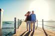 Leinwanddruck Bild - Senior couple walking on pier by Red sea. People enjoying vacation. Valentine's day
