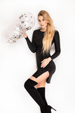 Blonde woman in fashionable party dress . - 247246453