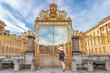 Leinwandbild Motiv Main golden door in exterior facade of Versailles Palace, Paris, France