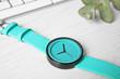 Leinwandbild Motiv Stylish wrist watch on wooden table. Fashion accessory