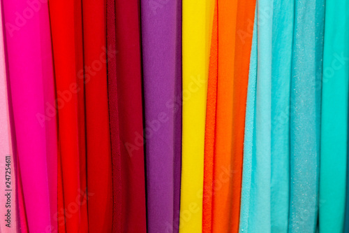 Colorful fabrics on the counter of the store. Sale