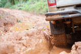 Off-road tires, Dirty offroad car, SUV covered with mud on countryside road.  offroad travel  and driving concept.