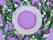 White roses and wreath on purple background