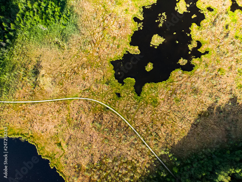 Aerial view of Varnikai cognitive walking way, leading through the most beautiful places of the Varnikai preserve, located near Trakai, Lithiania. - 247258263