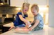 Leinwandbild Motiv Brother and Sister Baking