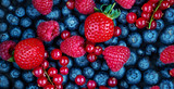 Summer Berries Background. Fresh  Berry mix with Strawberry, Raspberry, Red currant,  Blueberry and Blackberry, top view
