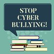 Word writing text Stop Cyber Bullying. Business concept for prevent use of electronic communication bully demonstrating Uneven Pile of Hardbound Books and Blank Rectangular Color Speech Bubble