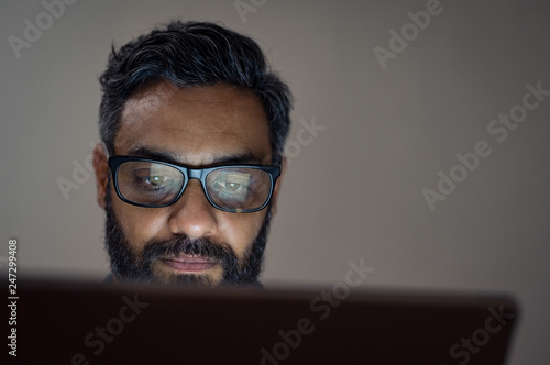 Man using laptop late night