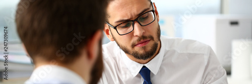 Leinwanddruck Bild Group of businessmen with financial graph and silver pen in arm solve and discuss problem with colleague portrait. Situation examination at board council sale adviser job stock exchange market profit