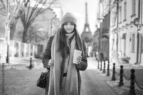 Girl in coat with coffee - 247317696