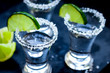 Quadro Set for tequila party with lime and salt on black background