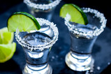 Set for tequila party with lime and salt on black background - 247341067