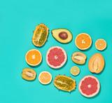Tropical Fruits Vegan Layout. Orange Lemon Citrus Avocado Grapefruit. Fresh Organic Food Concept. Flat lay. Creative Trendy fashion Style. Design Art. Summer Set.
