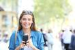 Leinwandbild Motiv Happy teen looks at camera listening to music