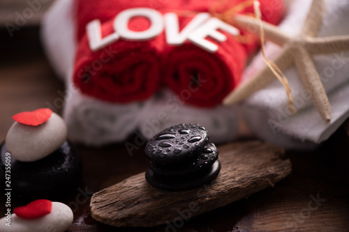 Wellness docoration on valentine's day with towels and stones - 247355059