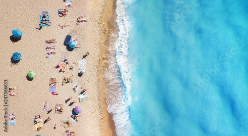 Foto Murales Beach and waves from top view. Turquoise water background from top view. Summer seascape from air. Top view from drone. Travel-image