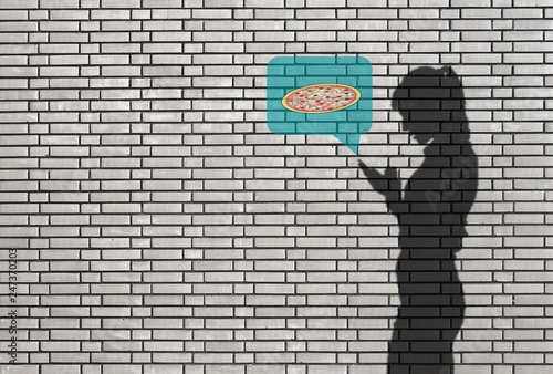 silhouette of woman with smartphone - ordering a pizza - 247370203