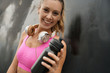 Leinwanddruck Bild - Happy fit woman in sportswear and workout accessories on black background