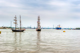 Tall Ship passing a tanker in the Tall Ships Regatta in London