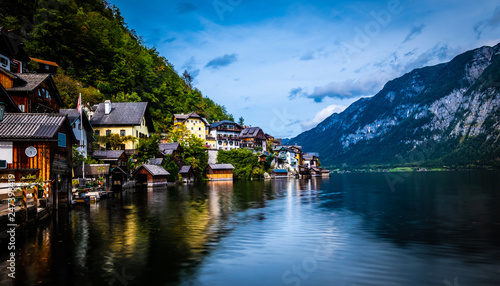 Evening scenery of lake and wooden buildings at the berth on the background of mountains in Hallstatt, Austria - 247398419