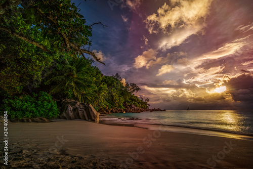 sunset on paradise beach at anse georgette, praslin, seychelles 4 - 247400494